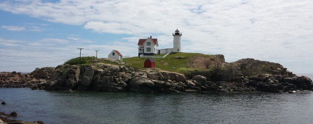 A lighthouse, a Beach, and the Lake Monster